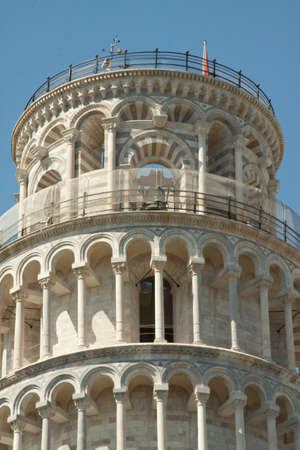 Close up of the upper levels of the leaning tower of Pisa photo