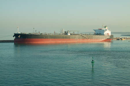 An empty bulk carrier waiting at the quayside for cargo photo