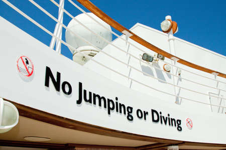 instructional: Instructional notice beside a swimming pool aboard a cruise ship Stock Photo