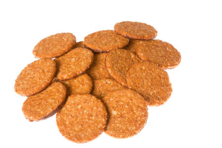 A large pile of chocolate oatmeal biscuits isolated against a white background photo