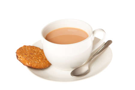 A cup of tea with chocolate oaty biscuits on the side photo
