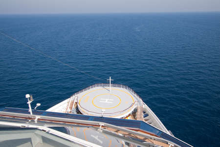 helicopter pad: The helicopter pad at the bow of a luxury cruise liner