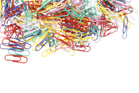 A pile of multicoloured paperclips isolated on a white background photo
