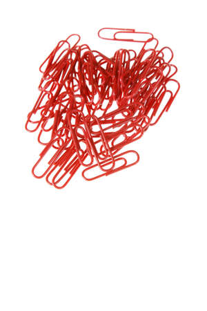 Close-up of a small pile of red paperclips photo