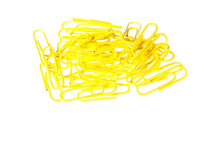 Close-up of a small pile of yellow paperclips photo
