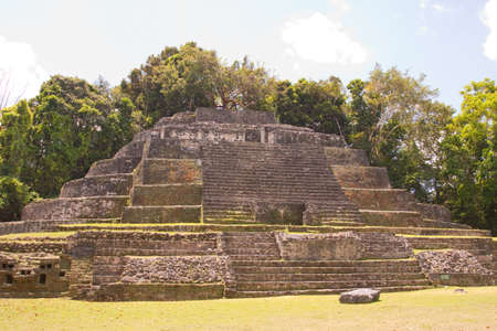 tourism in belize: The Jaguar temple in the ancient Mayan City of Lamanai in Belize, Central America Stock Photo