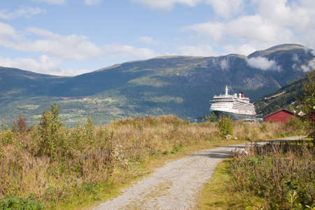 olden: A cruise ship moored alongside the Nordfjord in the village of Olden, Norway