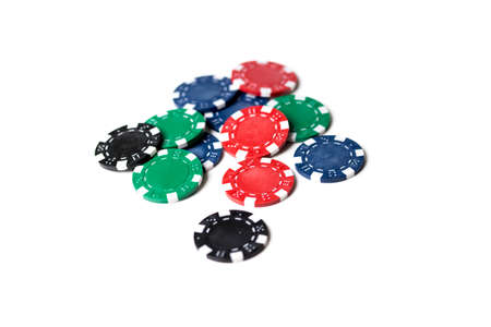 losing money: A scattering of asorted coloured gaming chips isolated against a white background