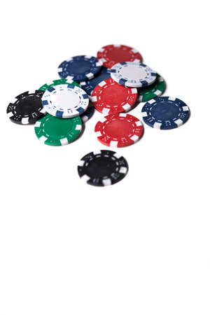 bets: A small heap of different coloured gaming chips isolated on a white background
