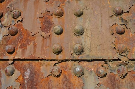 rust covered: Industrial Rivets Stock Photo