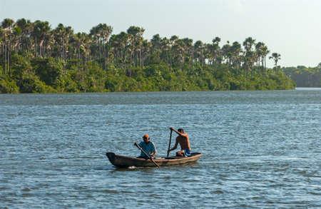 Canoe with two fishermen on the Preguiças River, in Lençois Maranhenses National Park, Barreirinhas, Maranhao, Brazil