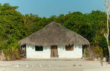 Typical thatched house, where part of the native population lives in the Lençois Maranhenses National Park, Barreirinhas, Maranhao, Brazil