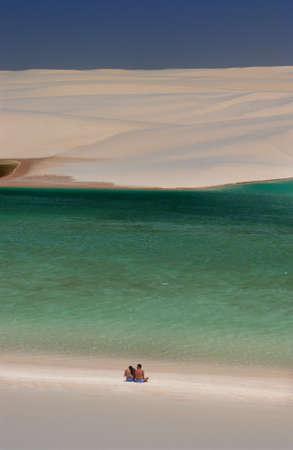 Tourists in lagoons surrounded by dunes in the Lençois Maranhenses National Park, Maranhão, Brazil Editorial