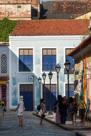 Sao Luis, Maranhao, Brazil on August 6, 2016. Tourists in the historic center, with windows, doors and tiles from the Brazilian colonial period.