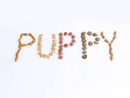 Aliments pour chiens �non�ant le chiot de mot