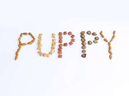 Dog Food Spelling Out the Word Puppy Stock Photo