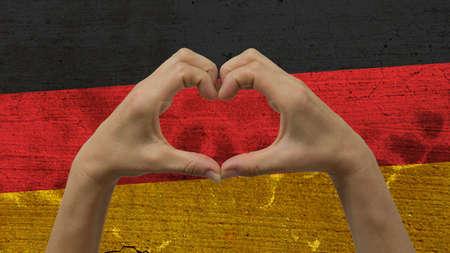 Mains Coeur drapeau allemand Banque d'images