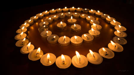 Burning Candles in Circles Stock Photo