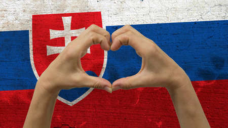 With a stylized Slovakia flag background an anonymous persons hands being held in the form of a heart, symbolizing love and patriotism for Slovakia.