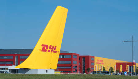 SCHKEUDITZ, GERMANY - SEPT 29, 2017: A wide overview shot of the DHL Courier building from the front sign that marks the location of the package sorting facility industrial complex.