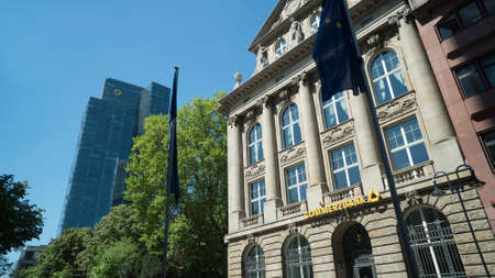 FRANKFURT, GERMANY - MAY 10, 2017: Front entrance sign of a Frankfurt Commerzbank branch location with Germany's second largest bank logo also on the Gallileo tower in the background. Redakční