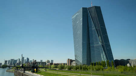 FRANKFURT, GERMANY - MAY 10, 2017: Frankfurt Germany downtown core in the background with the main tower building of the European Central Bank where monetary policy for Europe and the Eurozone is made.