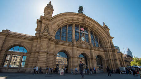 FRANKFURT, GERMANY - MAY 10, 2017: Outdoor front entrance shot of travelers coming and going in front of the main train station or Hauptbahnhof in Frankfurt Germany.