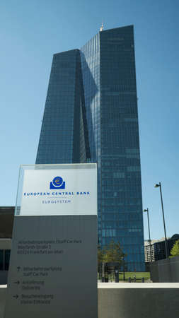 FRANKFURT, GERMANY - MAY 10, 2017: The main tower building of the European Central Bank in Frankfurt Germany where monetary policy for Europe and the Eurozone is made with the address sign in the foreground.
