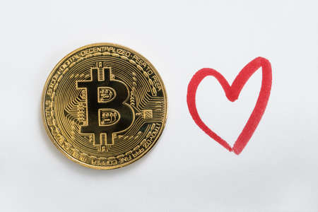 Bitcoin BTC cryptocurrency coin on a white background with a hand drawn red heart.
