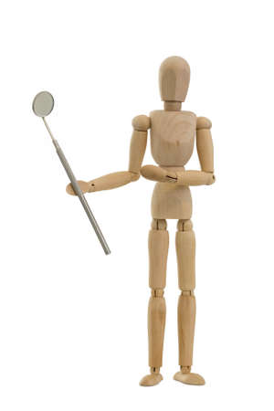 Wooden mannequin or figurine holding a dental mirror on a white background.