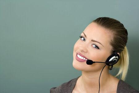 customer service representative: young female customer service representative smiling Stock Photo