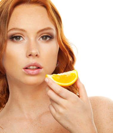 coloring lips: Model with slice of orange Stock Photo