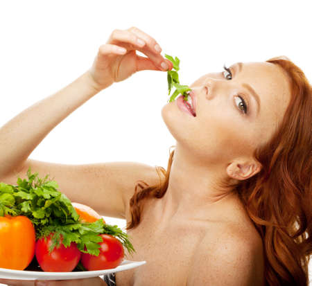 Model eating green salad from dish