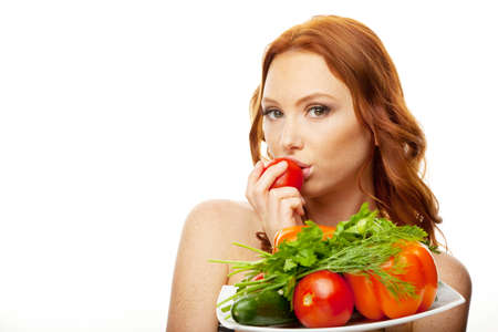 Young model with dish of vegetables Stock Photo
