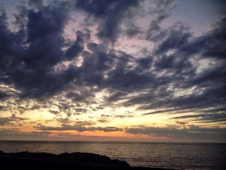dark: Sunset with dark clouds in the background