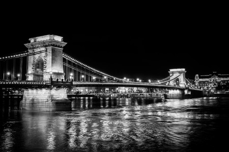 Chain Bridge illuminated from the Buda side, looking over into Pest across the Danube River