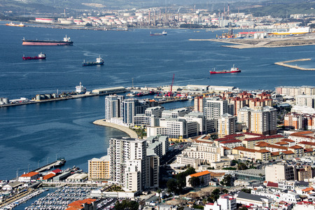 View from the Rock of Gibraltar, Gibraltar City and Gibraltar Bay (Bay of Algeciras).  The port is home to Europe's number one oil transfer ports one of the busiest along the eastern Mediterranean with over 100,000 ships passing through each year.