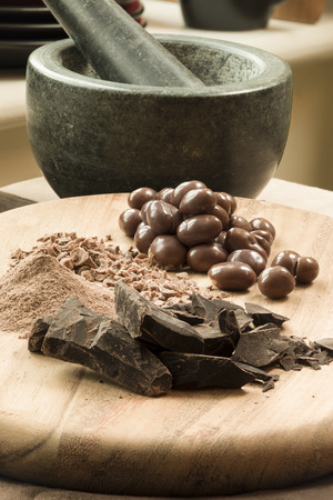 Chocolate in different forms including hard, powder, shavings, with candy, Standard-Bild