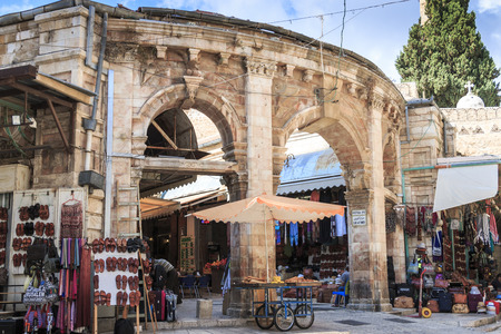 Historic entrance to Muristan area of the Jewish Quarter, market stalls and vendors light the street just as in biblical times. Editorial