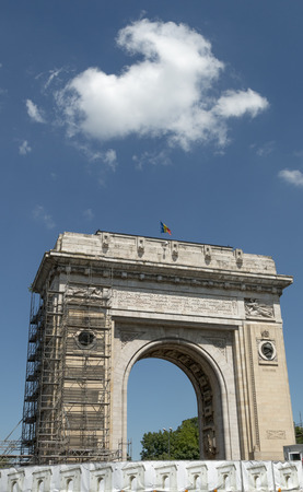Under renovation, the Triumphial Arch (Arcul de Triumf) was originally built in 1922 of wood to honor Romanian soldiers who fought in WW I.  The granite version was finished in 1936.