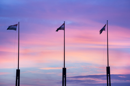 Hungarian national flags at sunset