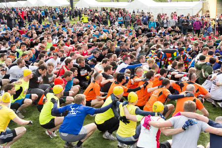 sportsmanship: Boughton House, NorthamptonshireUK - May 4:  Participants  warm-up for the annual  Tough Mudder extreme sports competition on May 4, 2013 in Northamptonshire, UK.  A portion of the funds went to support Help for Heros, a charity giving aide to those wo
