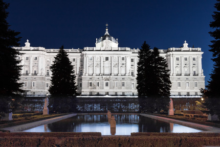 The Royal Palace in Madrid glows at night Editorial