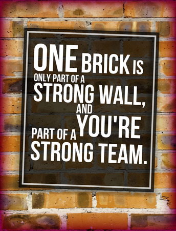 Brick wall with teambuilding phrase