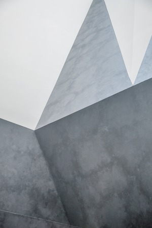 concrete structure: Abstract concret wall. interior with chaotic polygonal relief pattern on the wall