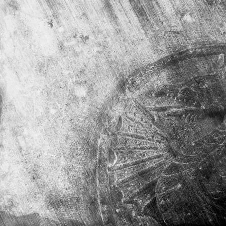 dragon: Carved dragon symbol on a medieval stone
