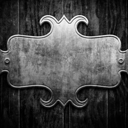 plaque: Plaque or sign consisting of a silver plate on wood Stock Photo