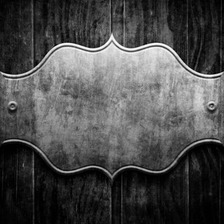 silver backgrounds: Plaque or sign consisting of a silver plate on wood Stock Photo