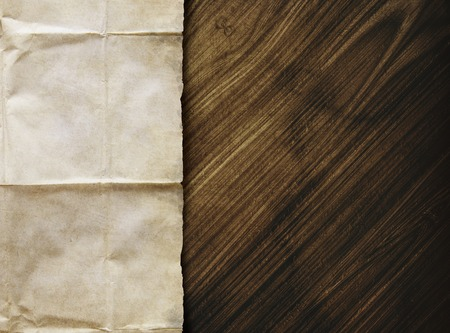 table scraps: Old brown papersheet on wooden table