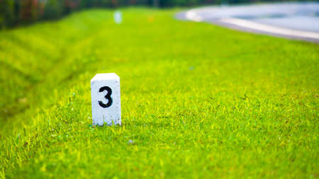 milestone: milestone on the grassland